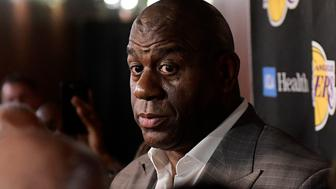 Magic Johnson speaks to reporters prior to an NBA basketball game between the Los Angeles Lakers and the Portland Trail Blazers on Tuesday, April 9, 2019, in Los Angeles. Johnson abruptly quit as the Lakers' president of basketball operations Tuesday night, citing his desire to return to the simpler life he enjoyed as a wealthy businessman and beloved former player before taking charge of the franchise just over two years ago. (AP Photo/Mark J. Terrill)