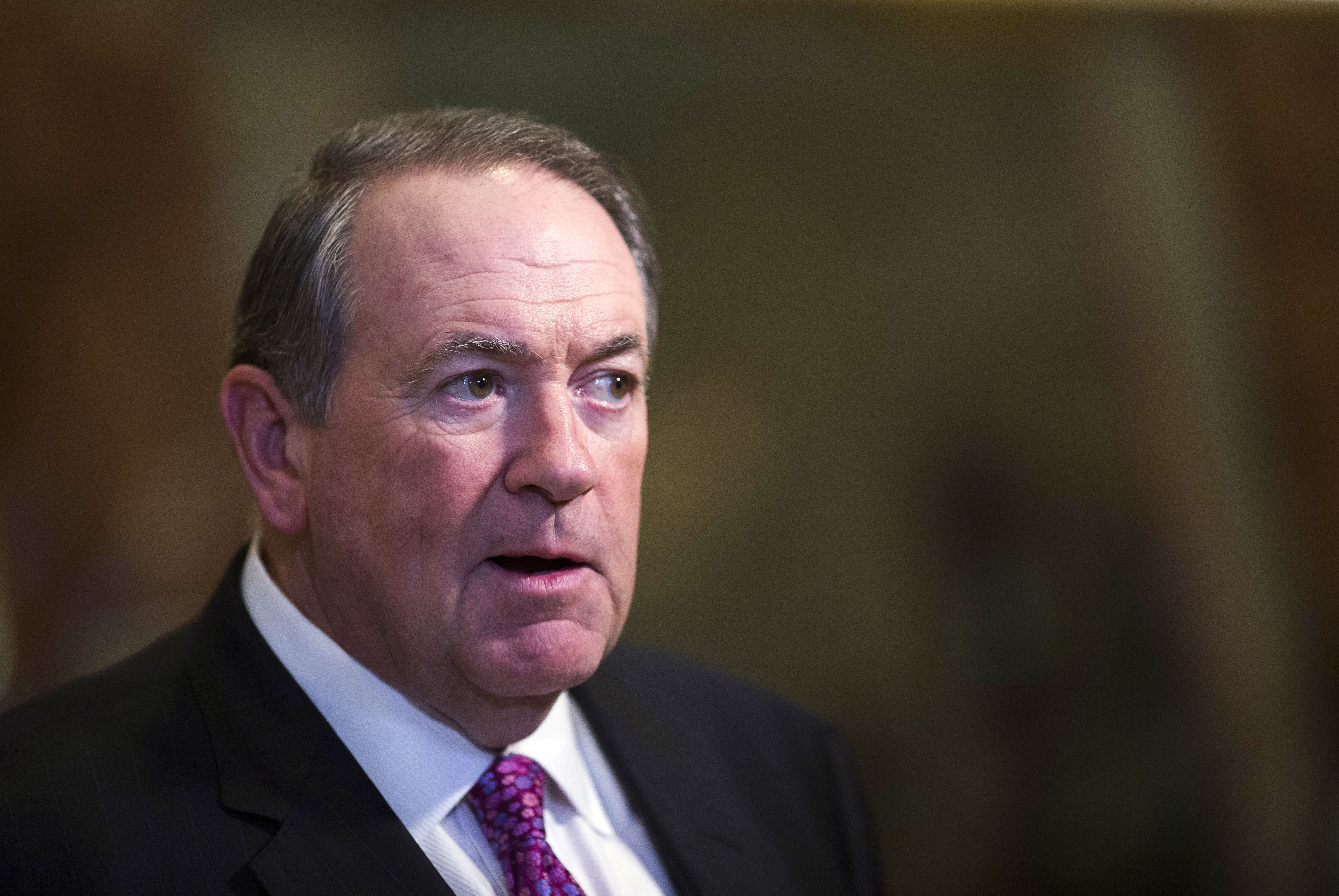 Mike Huckabee, former governor of Arkansas, speaks to members of the media in the lobby of Trump Tower in New York, U.S., on Friday, Nov. 18, 2016. Donald Trump on Friday selected Alabama Senator Jeff Sessions as his attorney general, elevating one of his earliest congressional backers and one of the most conservative U.S. lawmakers to serve as the nation's top law enforcement official. Photographer: John Taggart/Bloomberg via Getty Images