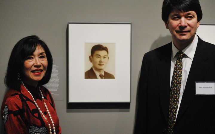 Karen and Ken Korematsu pose near photographs of their father, Fred Korematsu, during a presentation of his portrait to the N