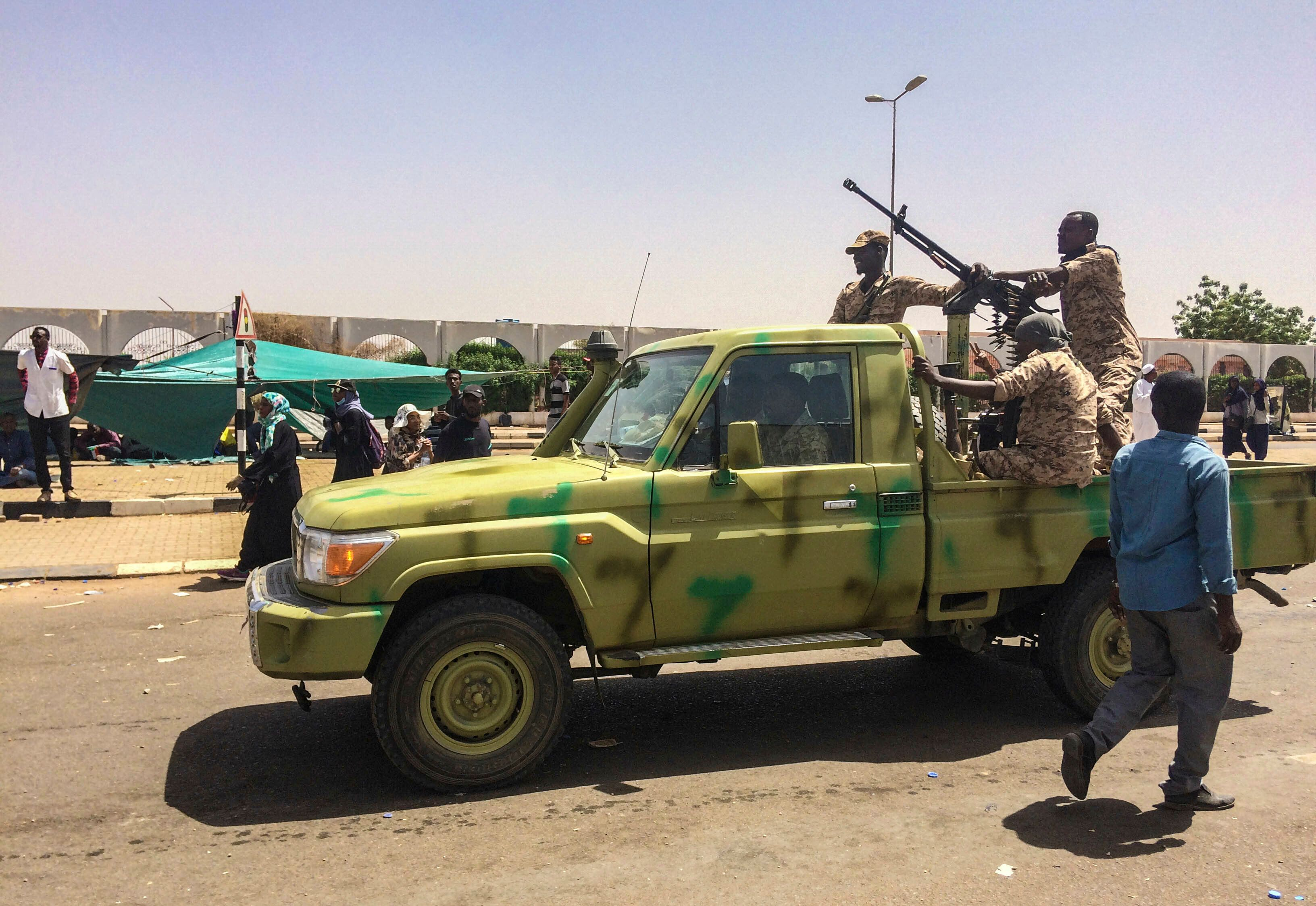 Sudanese army soldiers patrol near protesters gathered near the military headquarters, Tuesday, April 9, 2019, in the capital Khartoum, Sudan. Activists behind anti-government protests in Sudan say security forces have killed at least seven people, including a military officer, in another attempt to break up the sit-in outside the military headquarters in Khartoum. A spokeswoman for the Sudanese Professionals Association, said clashes erupted again early Tuesday between security forces and protesters who have been camping out in front of the complex in Khartoum since Saturday. (AP Photo)