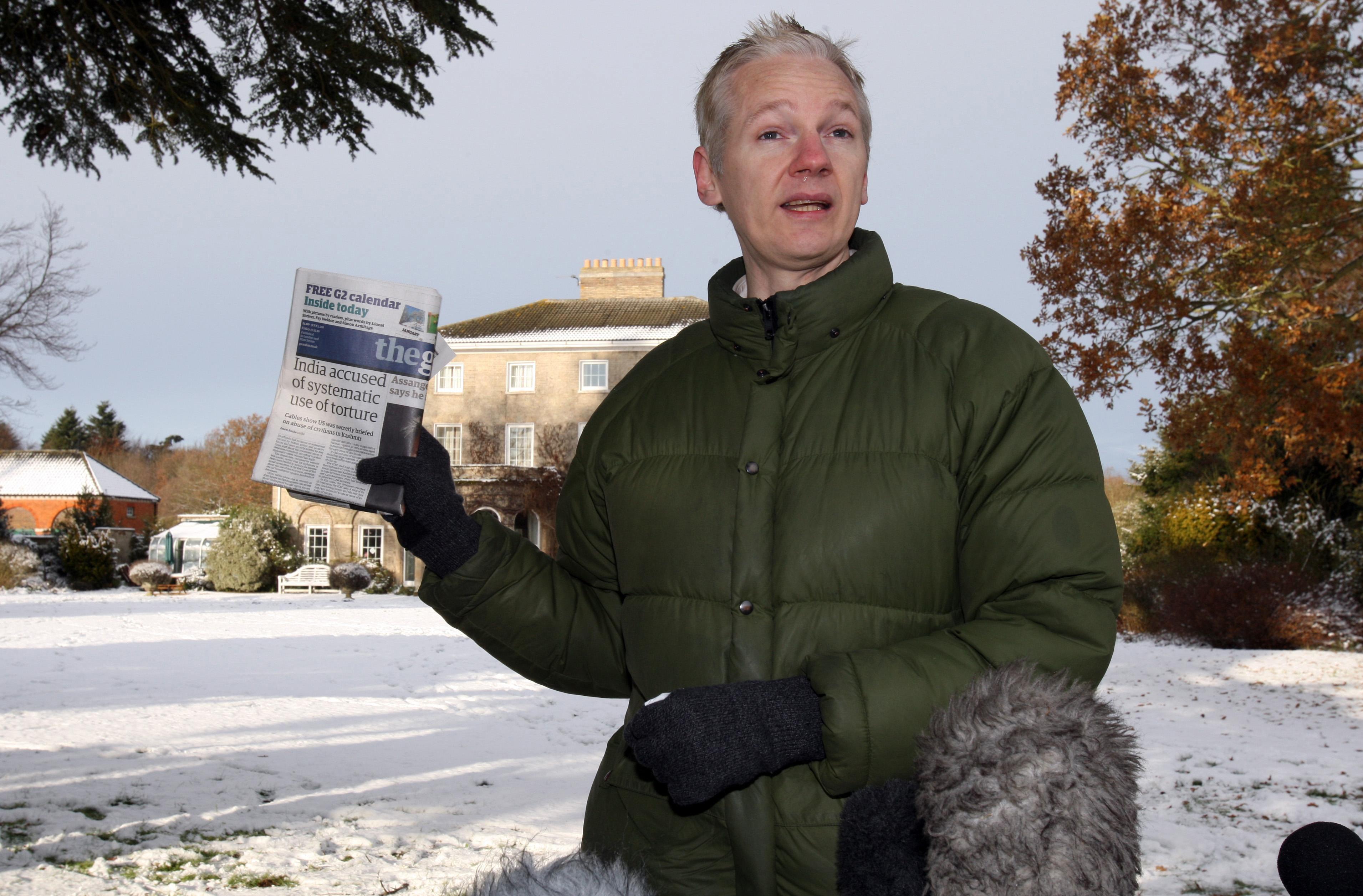 Assange addresses reporters outside Ellingham Hall in