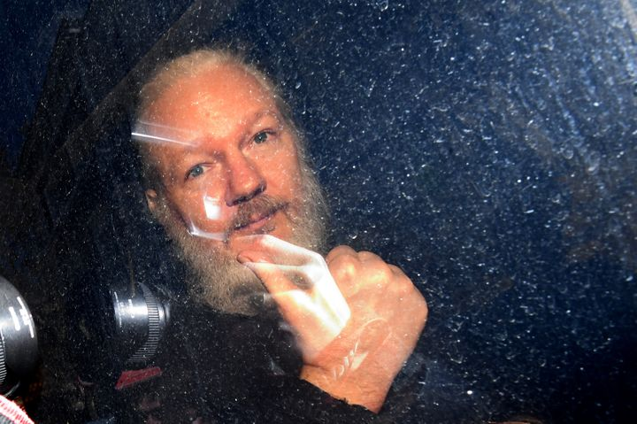 Julian Assange giving the thumbs up as he arrived at court.