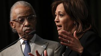 NEW YORK, NY - APRIL 5: (L-R) Rev. Al Sharpton looks on as Democratic presidential candidate U.S. Sen. Kamala Harris (D-CA) speaks at the National Action Network's annual convention, April 5, 2019 in New York City. A dozen 2020 Democratic presidential candidates are speaking at the organization's convention this week. Founded by Rev. Al Sharpton in 1991, the National Action Network is one of the most influential African American organizations dedicated to civil rights in America. (Photo by Drew Angerer/Getty Images)