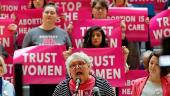 Karrie Galloway, of Planned Parenthood Association of Utah, speaks during a news conference at the Utah State Capitol Wednesday, April 10, 2019, in Salt Lake City. Abortion rights groups filed a lawsuit challenging the constitutionality of a new Utah law banning most abortions after 18 weeks of gestation, following through on a vow made when lawmakers considered the measure during this year's legislative session. (AP Photo/Rick Bowmer)