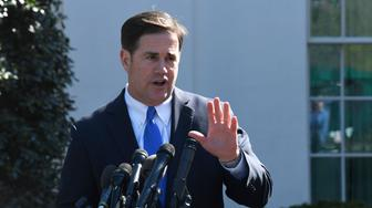 Arizona Gov. Doug Ducey talks to reporters outside the West Wing of the White House in Washington, Wednesday, April 3, 2019, following his meeting with President Donald Trump. (AP Photo/Susan Walsh)
