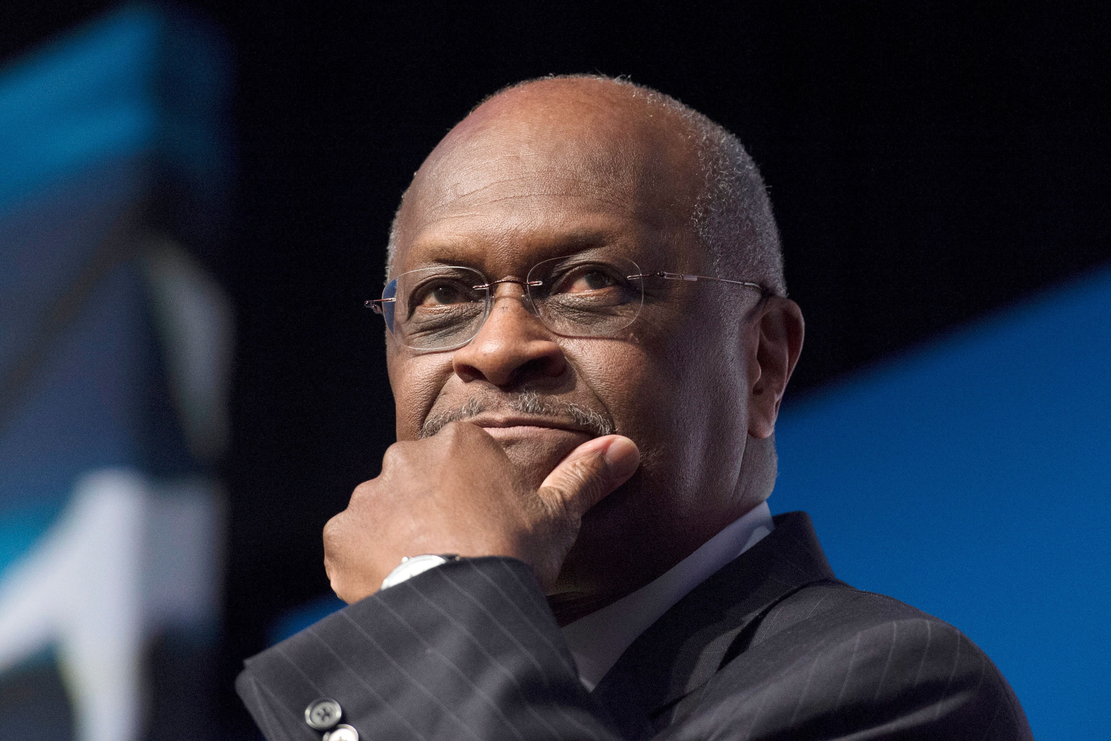 FILE - In this June 20, 2014 file photo, Herman Cain, CEO, The New Voice, speaks during Faith and Freedom Coalition's Road to Majority event in Washington. President Donald Trump said Thursday, April 4, 2019, he is recommending Herman Cain, a political ally and former presidential candidate, for a seat on the Federal Reserve board. (AP Photo/Molly Riley, File)