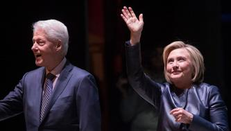 "Former President Bill Clinton, left, and former Secretary of State Hillary Rodham Clinton wave at the crowd as they arrive on stage for ""An Evening with the Clintons,"" at the Beacon Theatre Thursday, April 11, 2019, in New York. (AP Photo/Mary Altaffer)"