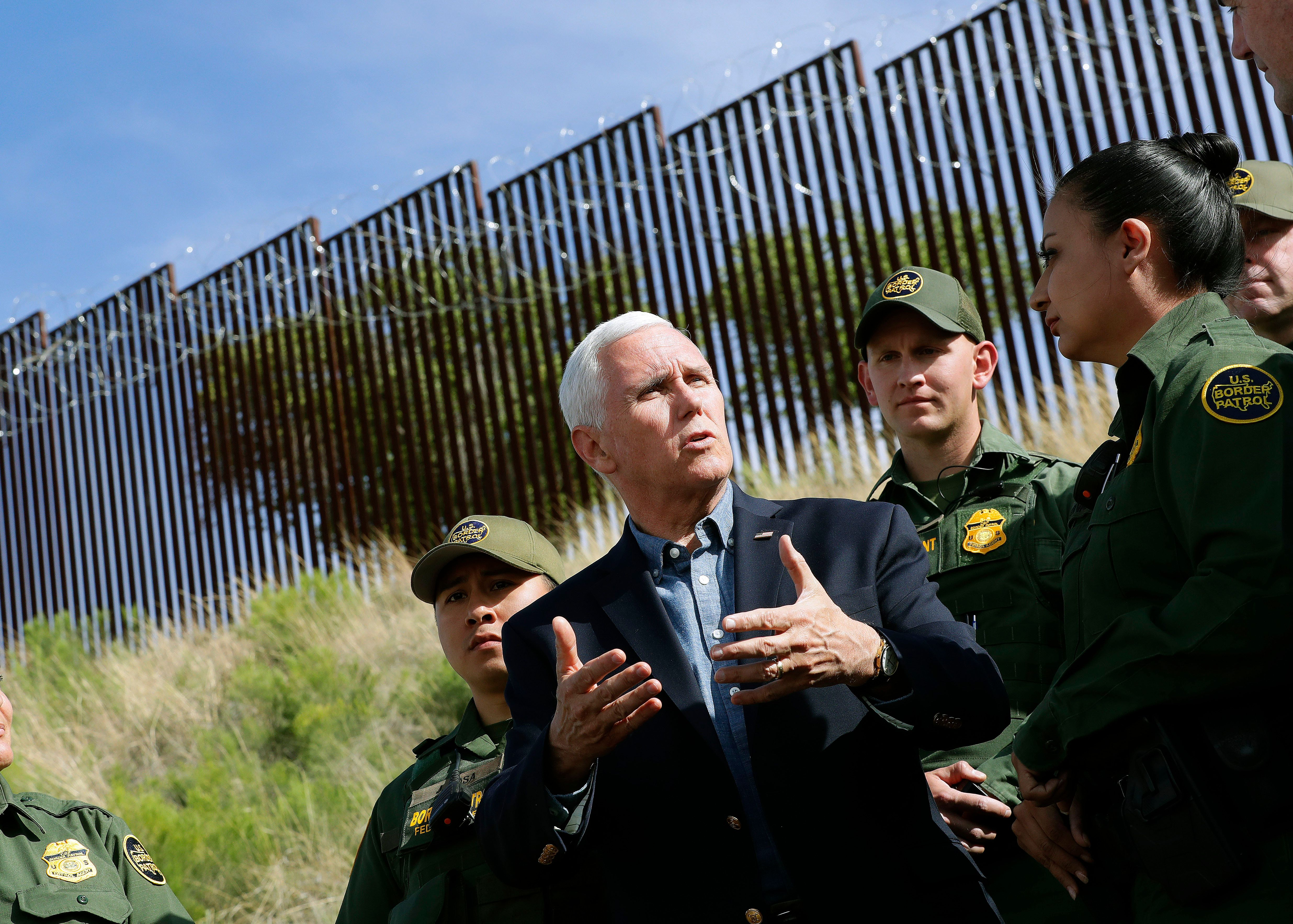 Vice President Mike Pence speaks along the International border while meeting with Customs and Border Patrol agents, Thursday, April 11, 2019, in Nogales, Ariz. (AP Photo/Matt York)