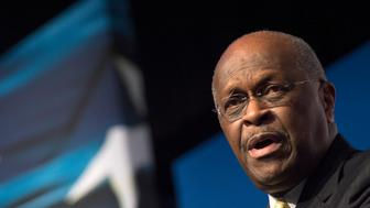 Herman Cain, CEO, The New Voice, speaks during Faith and Freedom Coalition's Road to Majority event in Washington, Friday, June 20, 2014. (AP Photo/Molly Riley)