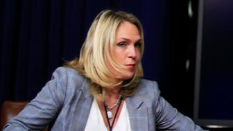 """FILE - In this March 22, 2018, file photo, Kelly Sadler, special assistant to President Donald Trump, attends a forum at the Eisenhower Executive Office Building on the White House complex in Washington. Sadler, who was dismissive of gravely ill Sen. John McCain during a closed-door meeting last month, has left the White House. White House spokesman Raj Shah says, """"Kelly Sadler is no longer employed within the Executive Office of the President."""" (AP Photo/Manuel Balce Ceneta, File)"""