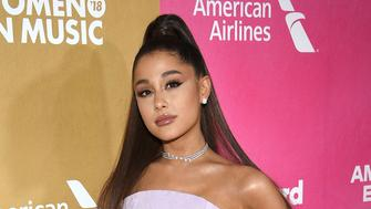 FILE - In this Thursday, Dec. 6, 2018 file photo, Ariana Grande attends the 13th annual Billboard Women in Music event at Pier 36, in New York. The organizers of the 2019 Coachella Valley Music and Arts Festival have announced the top acts scheduled to appear at the multiday event in April. Goldenvoice, the promoter of the event, said Wednesday night, Jan. 2, 2019, that the big names scheduled to perform at the two-weekend event from April 12 to April 14 and from April 19 to April 21 include Grande, Childish Gambino, Tame Impala and Janelle Monae. (Photo by Evan Agostini/Invision/AP, File)
