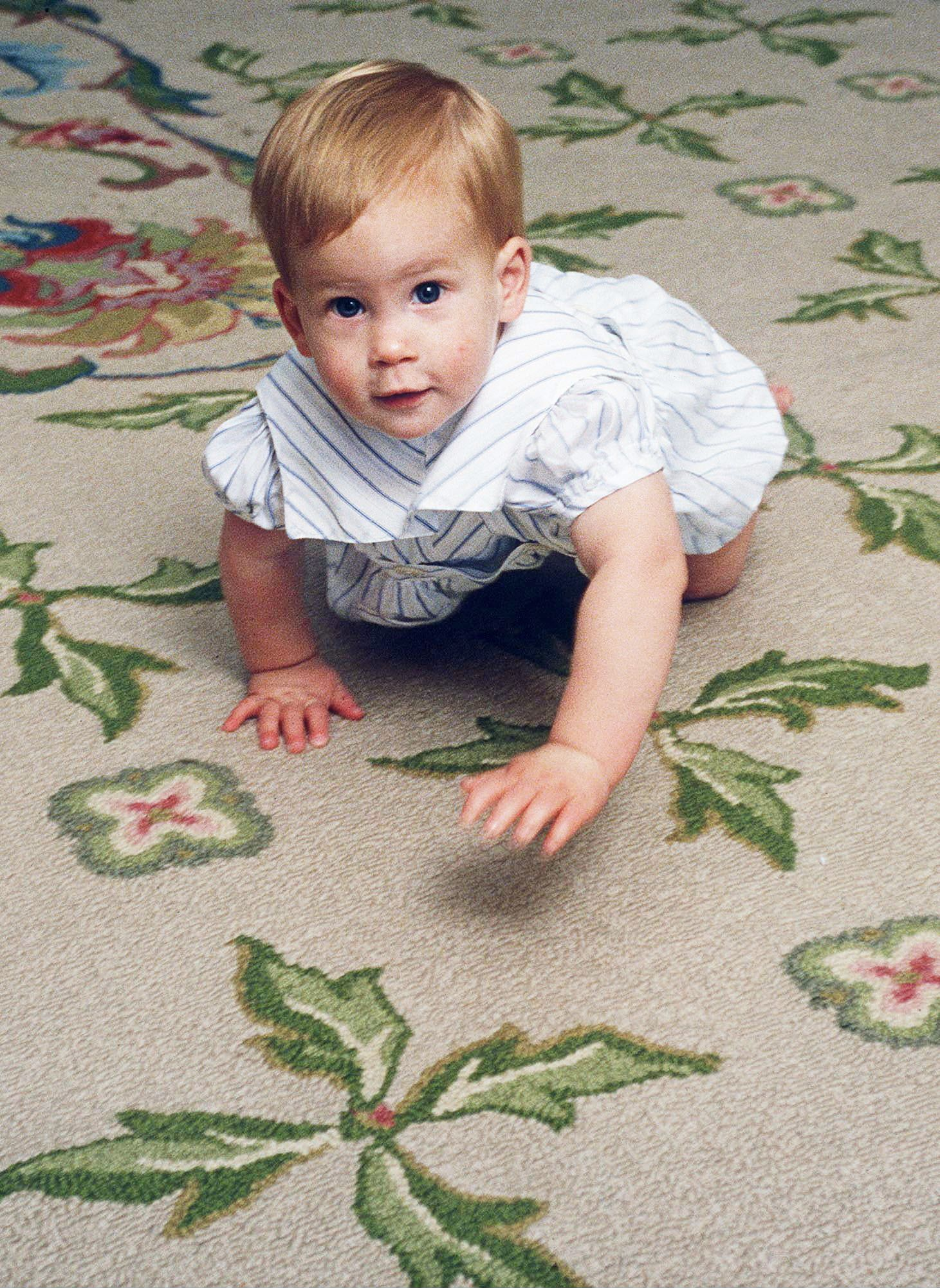 LONDON, UNITED KINGDOM - OCTOBER 04:  Prince Harry Learning To Crawl At Home In Kensington Palace.  (Photo by Tim Graham/Getty Images)