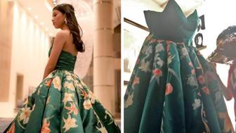 """Ciara Gan, a recent high school graduate in the Philippines, poses with the dress that has been called an """"absolute masterpiece"""" online."""