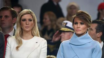 WASHINGTON, DC - JANUARY 20: First lady Melania Trump (R), stands with Ivanka Trump as a parade passes the inaugural parade reviewing stand in front of the White House on January 20, 2017 in Washington, DC. Donald Trump was sworn in as the nation's 45th president today.  (Photo by Mark Wilson/Getty Images)