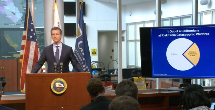 "Calfornia Gov. Gavin Newsom speaking at&nbsp;<a href=""https://www.caloes.ca.gov/cal-oes-divisions/news-media/cal-oes-live"">a"