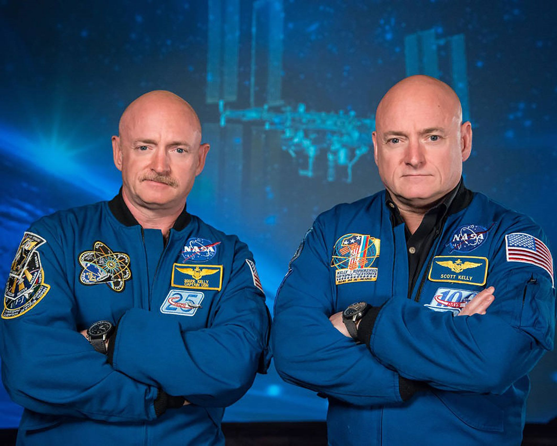 Former astronaut Scott Kelly (right) and his twin brother, former astronaut Mark Kelly (left), are seen in this NASA-supplied