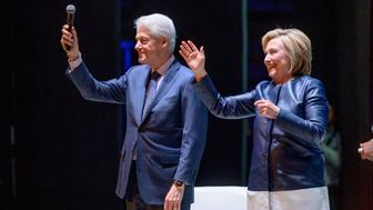 NEW YORK, NEW YORK - APRIL 11: Former President of the United States Bill Clinton with his wife, Former Secretary of State and presidential candidate Hillary Clinton on Stage during 'An Evening With The Clintons' at Beacon Theatre on April 11, 2019 in New York City. (Photo by Roy Rochlin/Getty Images)
