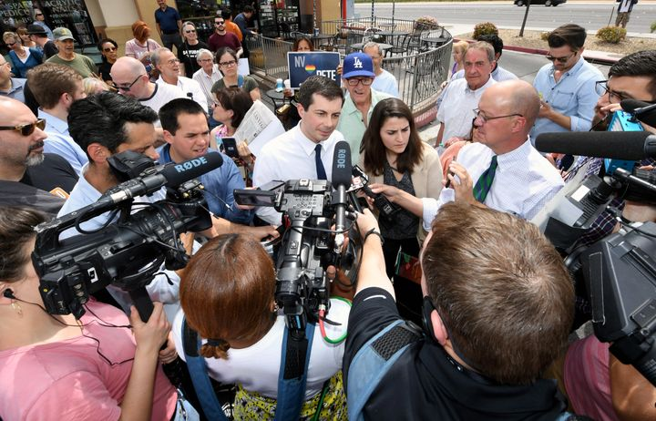 Buttigieg talks to members of the media outside Madhouse Coffee on April 8, 2019, in Las Vegas.