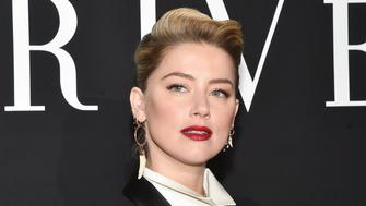 PARIS, FRANCE - JANUARY 22: Amber Heard attends the Giorgio Armani Prive Haute Couture Spring Summer 2019 show as part of Paris Fashion Week  on January 22, 2019 in Paris, France. (Photo by Stephane Cardinale - Corbis/Corbis via Getty Images)