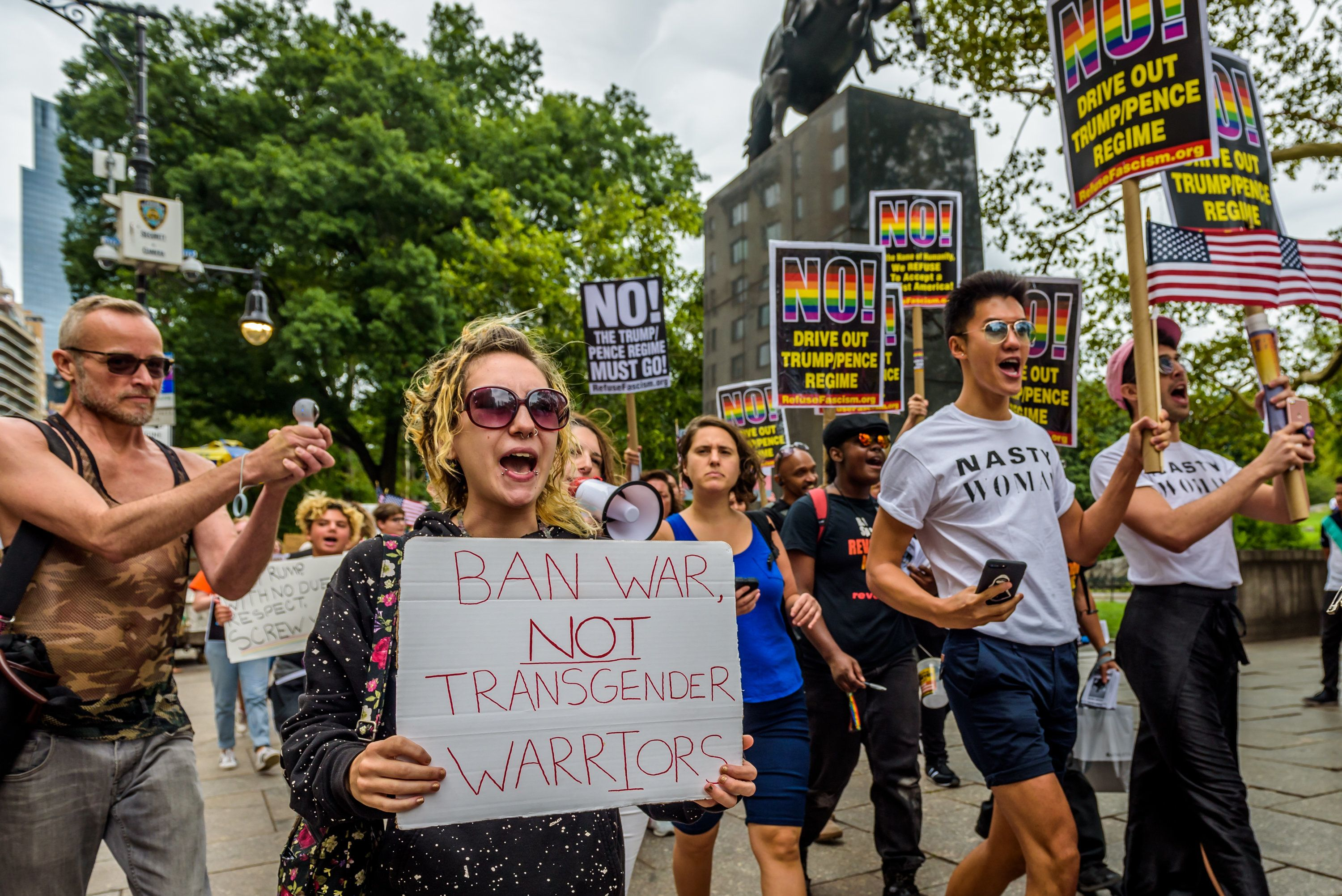 COLUMBUS CIRCLE, NEW YORK, UNITED STATES - 2017/07/29: A group of New Yorkers gathered at Columbus Circle across the Trump International Hotel and Tower New York in Central Park to raise their voices in protest against discrimination towards the LGBT community, in the aftermath of the Trump/Pence regime decision to ban transgender people from serving in the U.S. military. (Photo by Erik McGregor/Pacific Press/LightRocket via Getty Images)