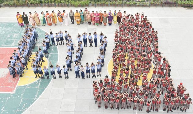 School children of Shri Ram Ashram Public School standing together to form martyrs memorial to pay tribute...