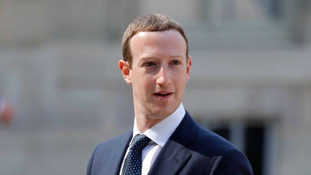 "Facebook's CEO Mark Zuckerberg, arrives to meet France's President Emmanuel Macron after the ""Tech for Good"" Summit at the Elysee Palace in Paris, Wednesday, May 23, 2018. French President Emmanuel Macron seeks to persuade Facebook CEO Mark Zuckerberg and other internet giants to discuss tax and data protection issues at a Paris meeting set to focus on how they could use their global influence for the public good. (AP Photo/Francois Mori)"
