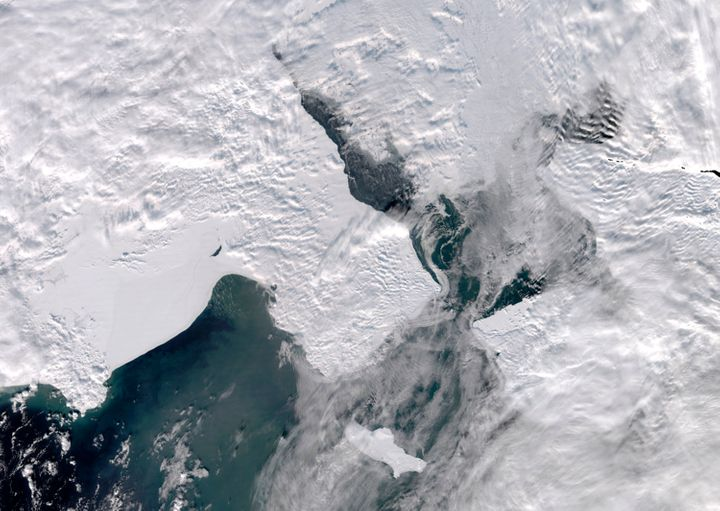 A satellite photo provided by the University of Alaska Fairbanks' Geographic Information Network of Alaska shows clouds parti