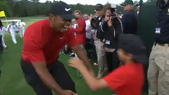 Tiger Woods embraces his son after Masters win