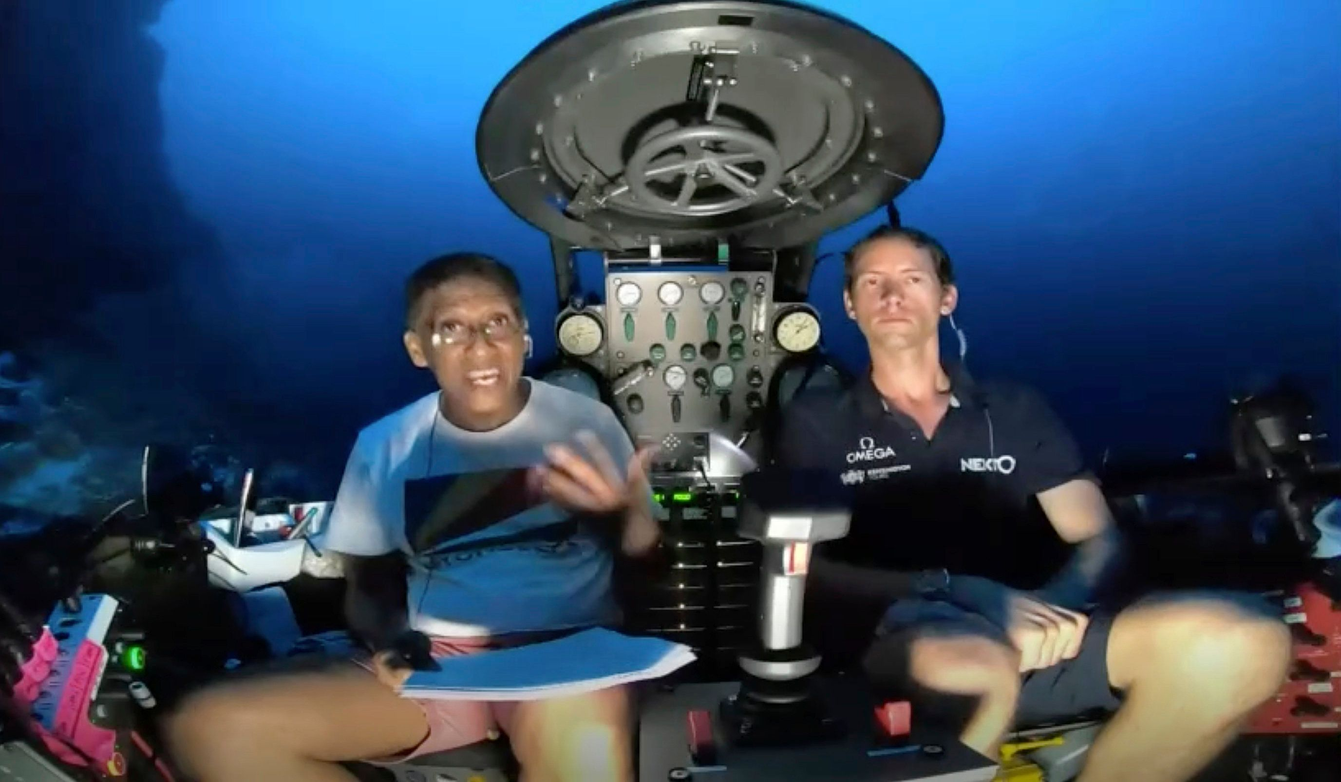 Seychelles President Danny Faure, left, delivered a deep-sea plea on Sunday, beseeching the world to...