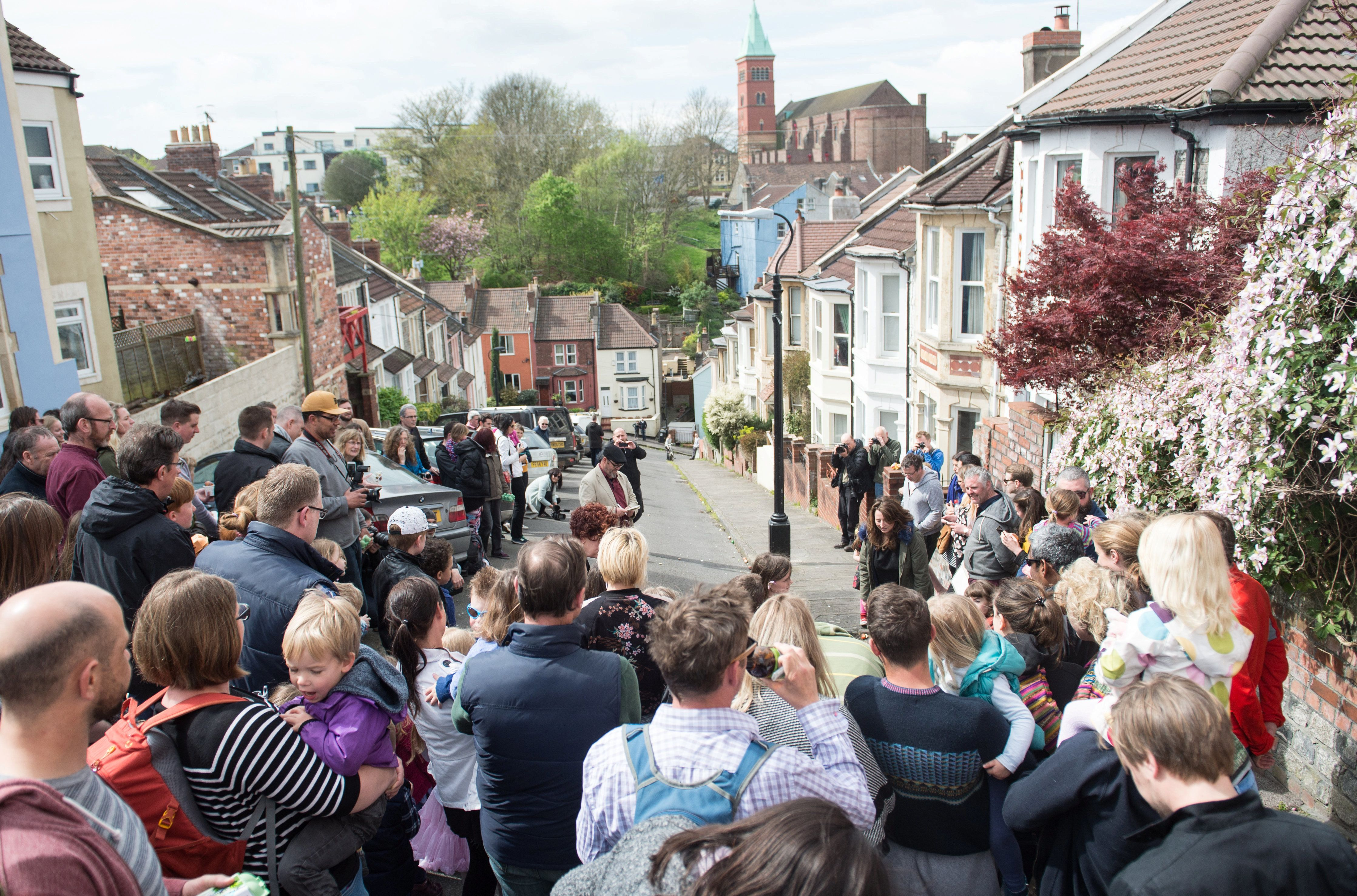 Vale Street, in Bristol, which is officially England's steepest street - according to Ordnance Survey. Pictured crowds have gathered for the annual egg rolling competition. (SWNS)