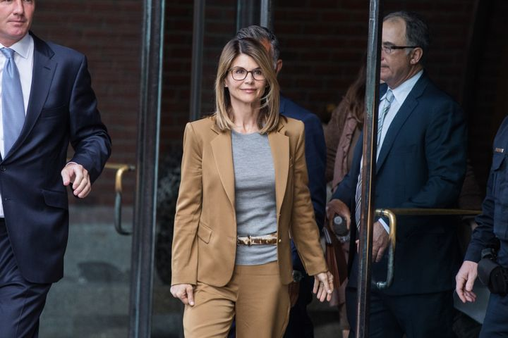 Actress Lori Loughlin, center, exits federal court in Boston, Massachusetts, U.S., on Wednesday, April 3, 2019. She and her husband, fashion designer Mossimo Giannulli, pleaded not guilty Monday.