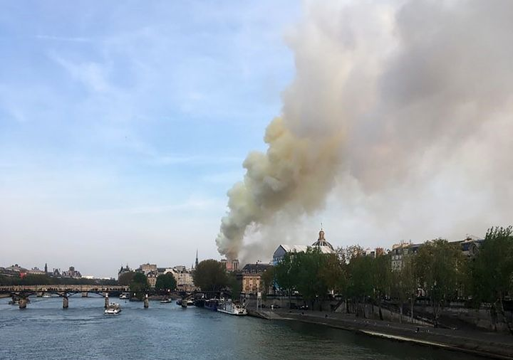 Flames and smoke are seen billowing from the roof at Notre-Dame Cathedral in Paris on Monday.