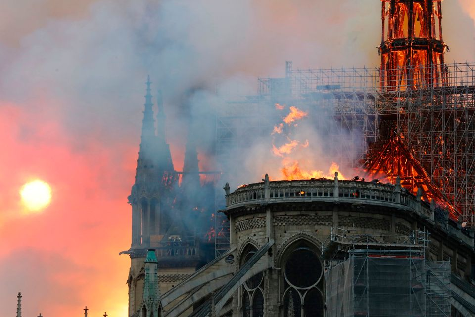 Smoke billows as flames destroy the roof of the landmark Notre Dame Cathedral in central Paris on April 15, 2019.
