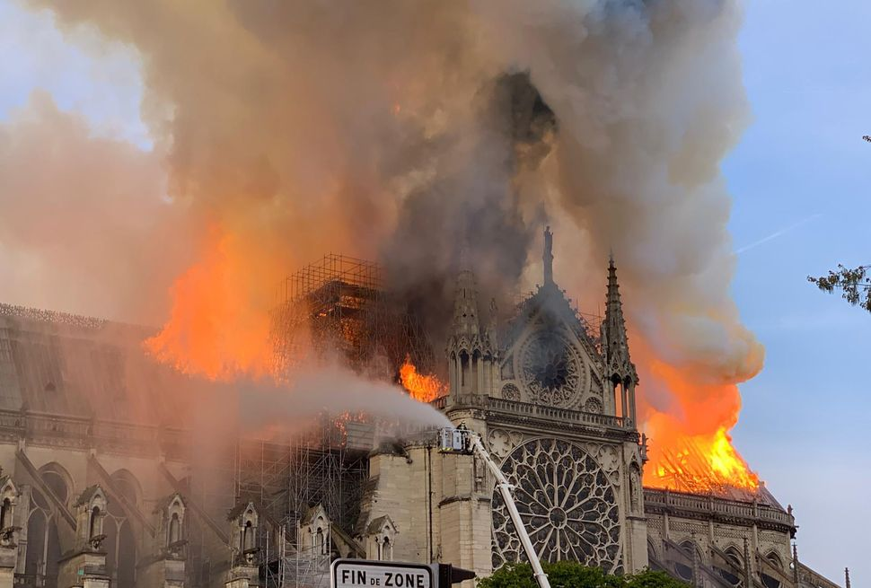 Flames tear through the roof at Notre Dame Cathedral in Paris on April 15, 2019.
