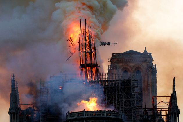 A huge fire swept through the roof of the famed Notre Dame Cathedral in central Paris on April 15, 2019,...