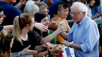 Presidential hopeful Sen. Bernie Sanders, right, greets supporters after a campaign rally, Sunday, April 14, 2019, in Pittsburgh. The Pittsburgh stop was part of a weekend tour of Midwest battleground states, including Wisconsin, Indiana, Ohio and Michigan. (AP Photo/Keith Srakocic)