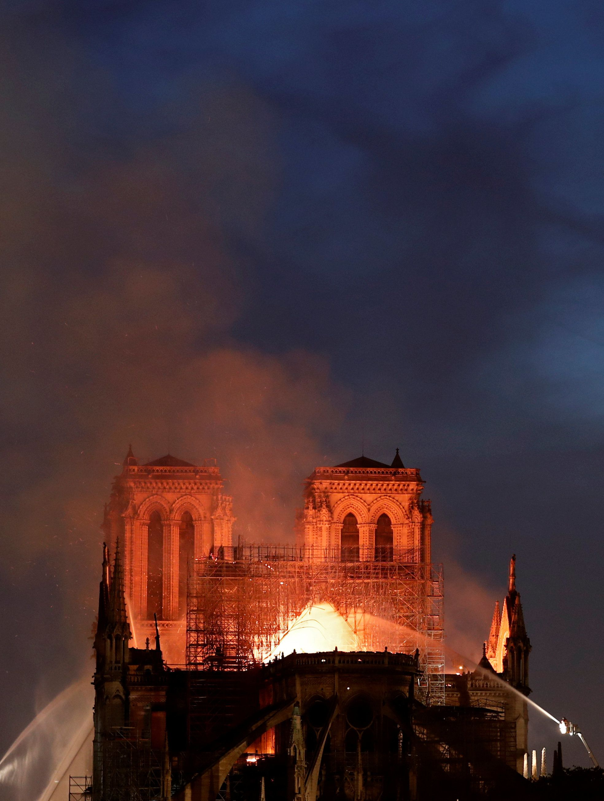 Within Minutes Of Notre Dame Cathedral Fire, Conspiracies Reigned