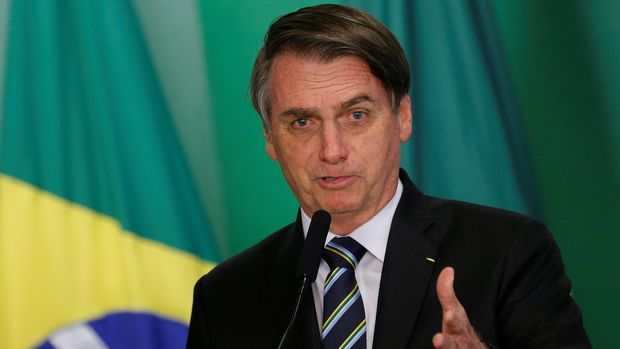 FILE PHOTO: Brazil's President Jair Bolsonaro speaks during inauguration ceremony of the new Education Minister Abraham Weintraub at the Planalto Palace in Brasilia, Brazil April 9, 2019. REUTERS/Adriano Machado/File Photo