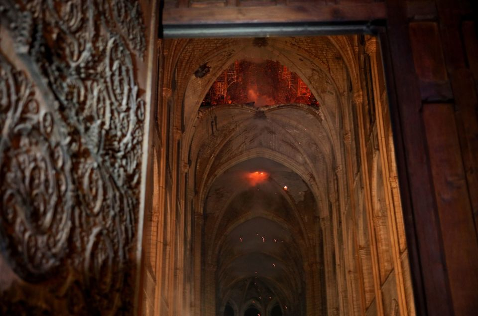 A spectacular image showed the ancient roof alight from within the