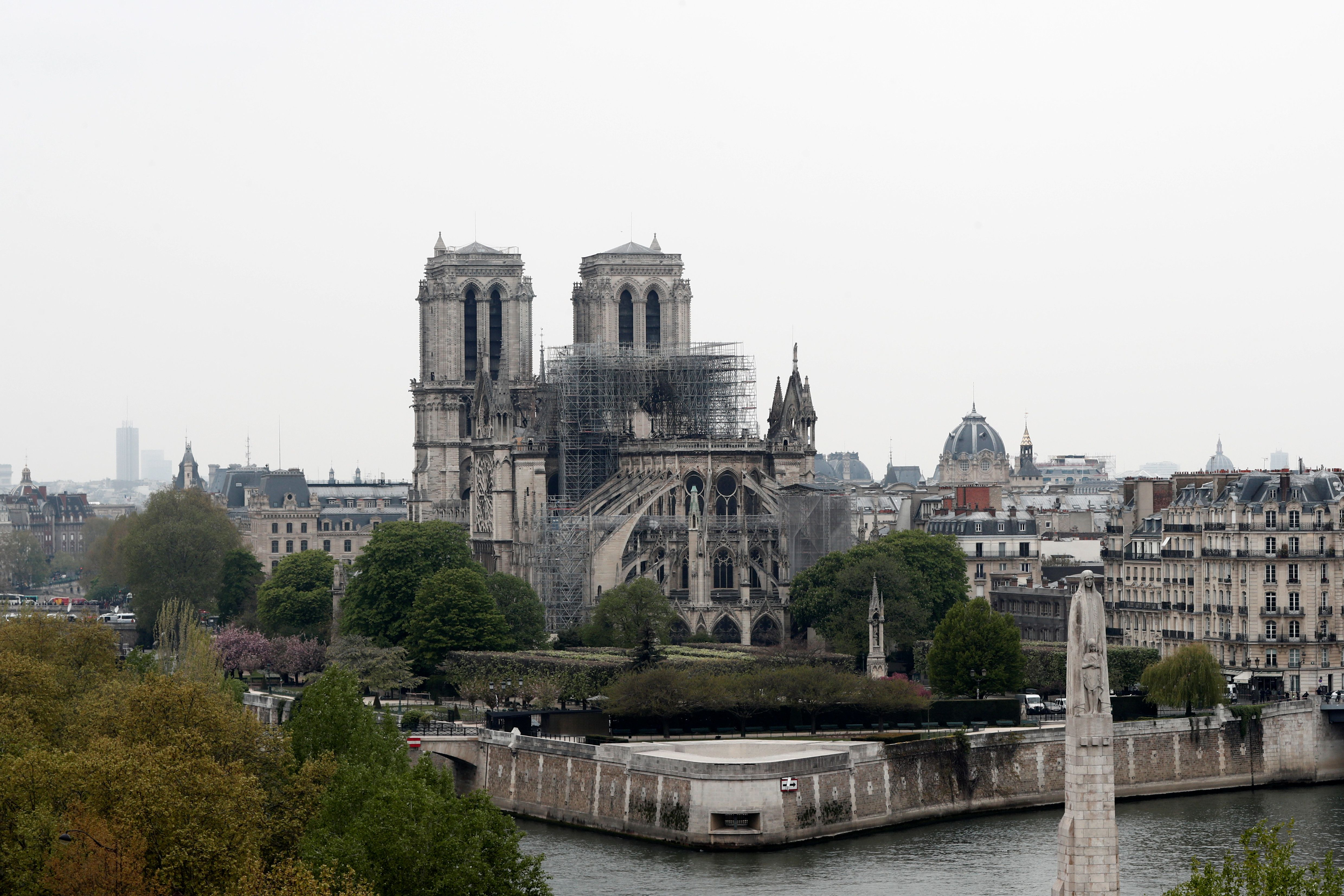 A view shows Notre-Dame Cathedral after a massive fire devastated large parts of the gothic gem in Paris, France, April 16, 2019.  REUTERS/Benoit Tessier