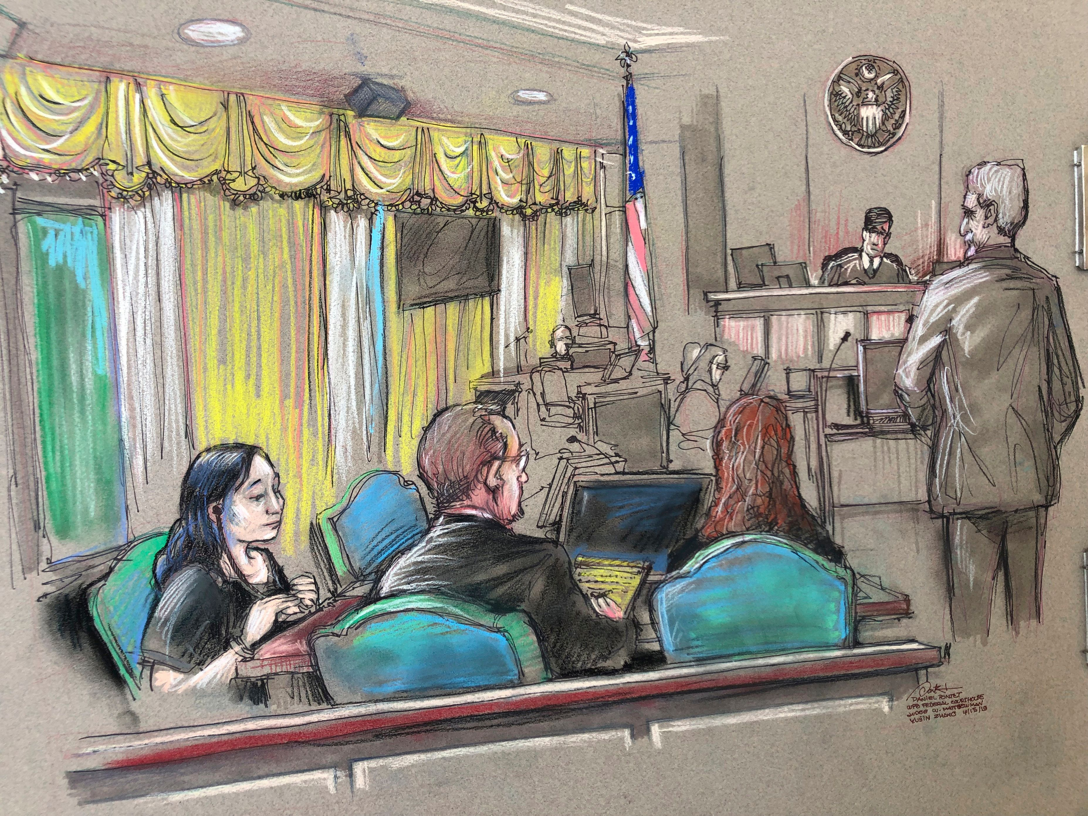 Yujing Zhang, left, who is charged with lying to illegally enter President Donald Trump's Mar-a-Lago club, listens to a heari