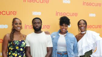LOS ANGELES, CA - JULY 21:  (L-R)  Actors Issa Rae, Y'lan Noel, Natasha Rothwell and Yvonne Orji attend HBO's Insecure Block Party at Banc of California Stadium on July 21, 2018 in Los Angeles, California.  (Photo by FilmMagic/FilmMagic for HBO )