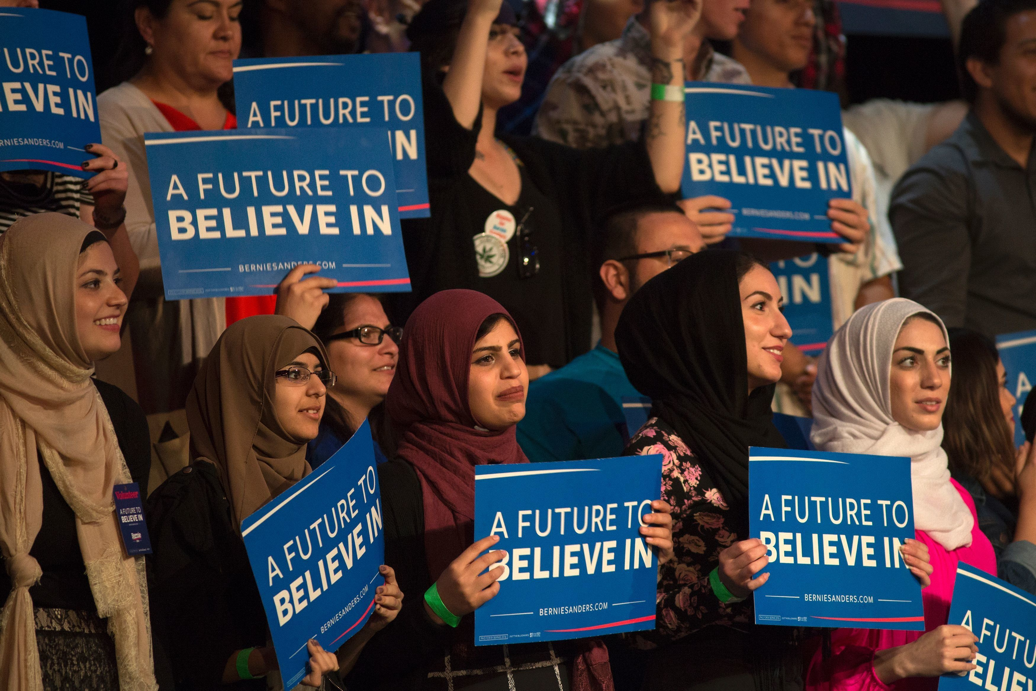 Muslim woman support Democratic presidential candidate Bernie Sanders during his campaign rally at the Riverside Municipal Auditorium on May 24, 2016 in Riverside, California.  US presidential candidates have turned their attention to campaigning in earnest for the June 7th California primary election. / AFP / DAVID MCNEW        (Photo credit should read DAVID MCNEW/AFP/Getty Images)
