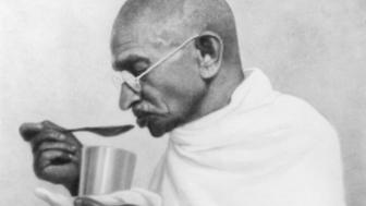 Indian statesman and activist Mohandas Karamchand Gandhi (1869 - 1948) takes his last meal before his fast at Rashtriyashala Ashram, Rajkot, March 1939. (Photo by Dinodia Photos/Getty Images)