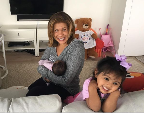 Hoda Kotb holds her newly adopted daughter, Hope Catherine, while her older daughter, Haley Joy, smiles.