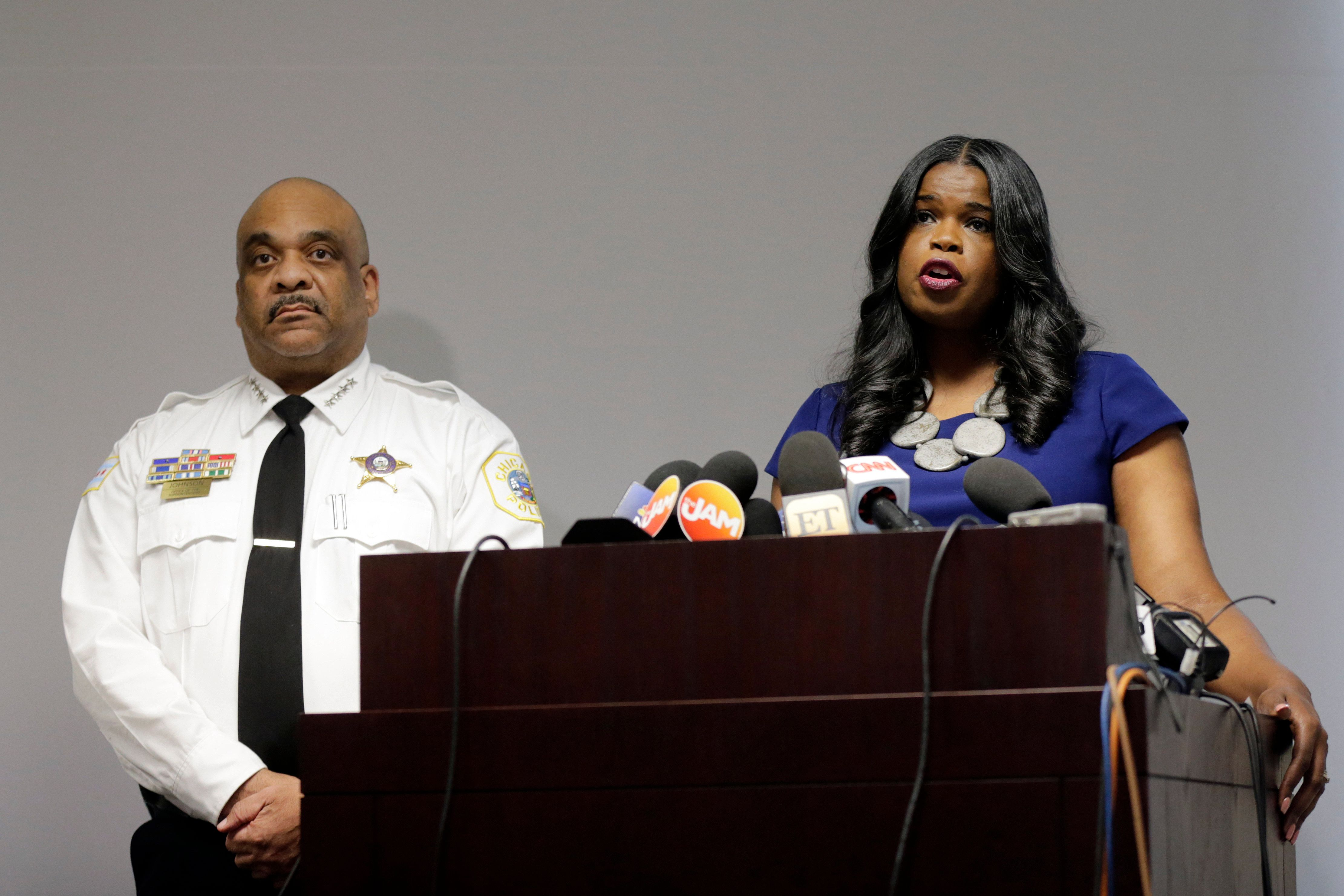 "FILE - In this Feb. 22, 2019, file photo, Cook County State's Attorney Kim Foxx, right, speaks at a news conference as Chicago Police Superintendent Eddie Johnson listens in Chicago. The outrage was swift and overwhelming: How could prosecutors in Chicago drop charges against former ""Empire"" cast member Jussie Smollett for allegedly orchestrating a fake attack and allow him to wipe his record clean without so much as an apology? But for all of the public outrage, the Chicago Police Department and Cook County State's Attorney's Office insist their relationship is strong, even if they didn't agree on the outcome in Smollett's case. (AP Photo/Kiichiro Sato, File)"