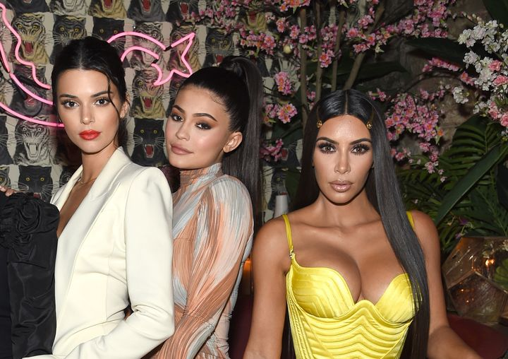 Kendall Jenner, Kylie Jenner and Kim Kardashian pose together at an event in New York City.