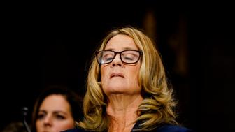 WASHINGTON, DC - SEPTEMBER 27: Christine Blasey Ford takes a breath at a Senate Judiciary Committee hearing on Thursday, September 27, 2018 on Capitol Hill. (Melina Mara/Pool/The Washington Post via Getty Images)
