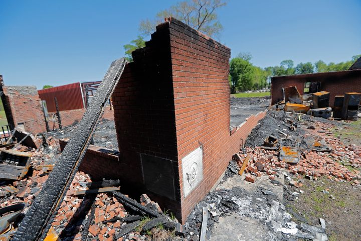 The ruins of the St. Mary Baptist Church, one of three churches that recently burned in St. Landry Parish, in Port Barre, La.