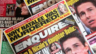 CHICAGO, ILLINOIS - APRIL 11: In this photo illustration, celebrity gossip dominates the cover of a National Enquirer magazine on April 11, 2019 in Chicago, Illinois.  American Media Inc., the parent company of the National Enquirer has put the magazine and some of their other tabloids up for sale. (Photo Illustration by Scott Olson/Getty Images)
